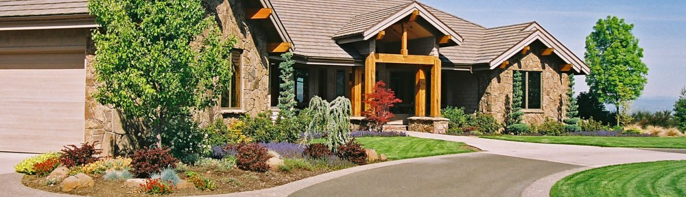 Photograph of a custom home landscape design by Naturescape Designs landscape designer
